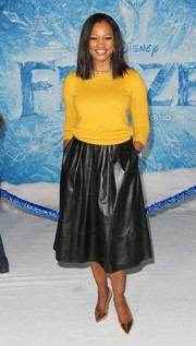 Garcelle Beauvais paired her sweater with a black leather skirt for a casual-smart finish.