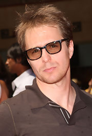 Sam wore a classic wayfarer-style sunglasses with light brown lenses.