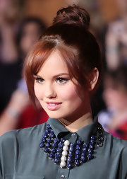 Debby Ryan wore her hair in an adorable top knot with long side-swept bangs at the premiere of 'John Carter.