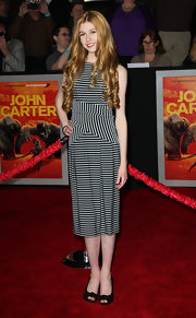 Katherine paired her striped dress with classic peep-toe pumps.