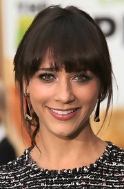 Rashida Jones were her hair in a simple bobby-pinned updo with pretty eye-enhancing bangs and face-framing tendrils at the premiere of 'The Muppets.'