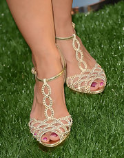 Cheryl's metallic gold sandals bedecked in crystals dazzled at the premiere.