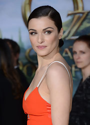 Rachel Weisz's chocolate locks were smooth and shiny when pulled back into a tight twisted bun.