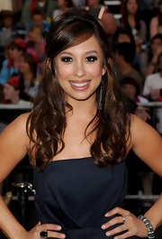 Cheryl Burke styled her hair in a half up half down hairstyle that was full of curls.