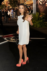 Eva Longoria gave her white shift pop with melon platform Maniac pumps.