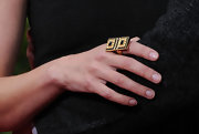 Actress Jaime King paired her dazzling dress with a black and gold cocktail ring. Perfection!
