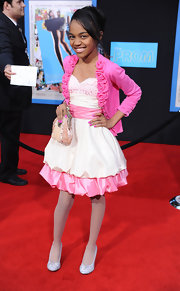 China Anne McClain added a twist to her pink and white themed outfit by wearing light blue pumps to the 'Prom' premiere.