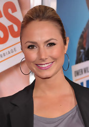 Actress Stacey Keibler added a pop of color to her look with magenta pink lipstick.