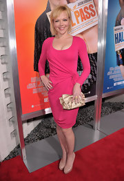 Emily is bright and bold in a hot pink faux wrap cocktail dress an a gold bow clutch at the premiere of 'Hall Pass.'