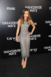 Jamie Chung matched her silver knit dress with a gray suede envelope clutch.