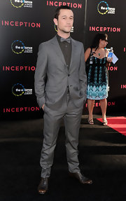Joseph rocks a slate gray men's suit with a matching bow tie.