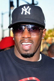 Sean Combs accessorized with a pair of modern rimless sunglasses at the premiere of 'Lottery Ticket.'