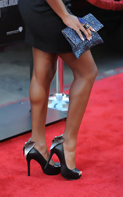 Naturi showed off her glittering clutch while walking the red carpet at the 'Lottery Ticket' premiere.