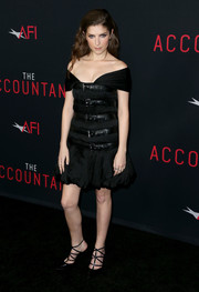 Anna Kendrick went for bondage glamour in a Moschino off-the-shoulder LBD with belt and buckle detailing during the premiere of 'The Accountant.'