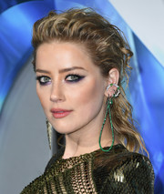 Amber Heard accessorized with a gemstone teardrop hoop, among other bling.