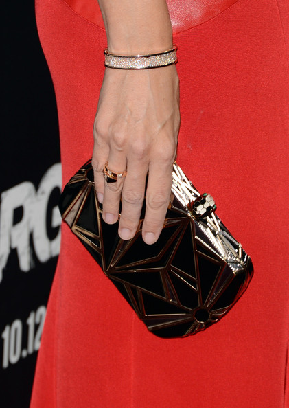 Jennifer Garner wore a bold bronze geometric clutch with her vibrant red gown.