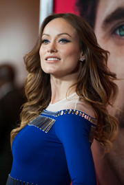 Olivia Wilde wore her hair in a lovely cascade of waves when she attended the premiere of 'Her' in LA.