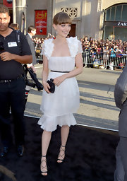 Bella Heathcote carried a contrasting evening clutch to finish her angelic ensemble at the movie premiere.