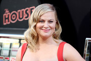 Amy Poehler showed off vintage-glam waves at the premiere of 'The House.'