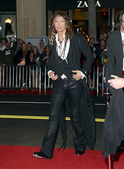 Steven Tyler stuck to his signature rocker duds with these leather pants and long striped jacket.