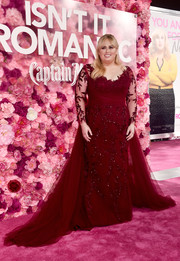 Rebel Wilson looked queenly in an embroidered red Paolo Sebastian gown with a flowing train at the premiere of 'Isn't It Romantic.'