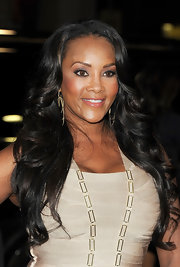 Vivica A. Fox looked stunning wearing silvery metallic shadow and long feathery lashes at the premiere of 'Joyful Noise.' Vivica's makeup artist Tai Young used M.A.C. Artjam paint and blended YSL #1 Chromatics palette on top.