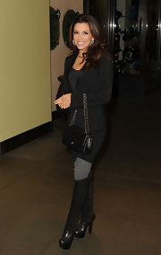Eva Longoria maintained her sleek premiere look with a black blazer and matching knee high boots.