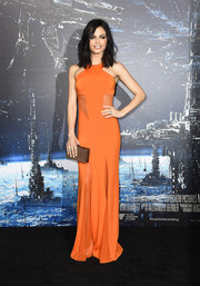 Jenna Dewan-Tatum wowed in a bright orange Cushnie et Ochs gown, featuring see-through panels along the waist and on the skirt, during the 'Jupiter Ascending' premiere.