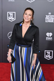 Diane Lane teamed a black box clutch with a tunic and a striped ball skirt for the premiere of 'Justice League.'