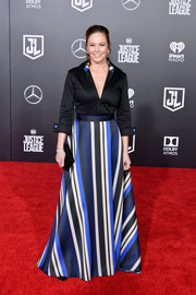 Diane Lane attended the premiere of 'Justice League wearing a deep-V black tunic by Jesus & Antonio Estrada.