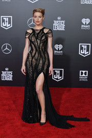 Amber Heard went for edgy glamour in a beaded black meshwork gown by Atelier Versace at the premiere of 'Justice League.'