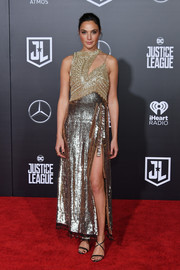 Gal Gadot stood out so effortlessly in a gold sequin dress by Altuzarra, boasting a high side slit and a modern asymmetrical bodice, at the premiere of 'Justice League.'