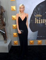 Poppy Delevingne went for sultry glamour in a black slip gown when she attended the premiere of 'King Arthur: Legend of the Sword.'