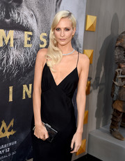 Poppy Delevingne accessorized with a mirrored silver box clutch for some shine to her black dress at the premiere of 'King Arthur: Legend of the Sword.'