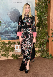 Margot Robbie finished off her outfit with sky-high black platform pumps, also by Gucci.