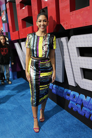 Stephanie Beatriz completed her colorful ensemble with a pair of fuchsia sandals by Stuart Weitzman.