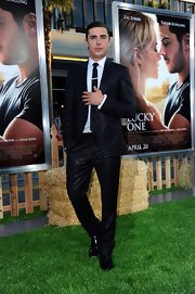 Zac Efron looked so very 'GQ' in this black suit with a sheen.