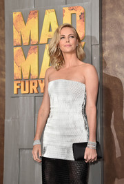 Charlize Theron amped up the glamour at the 'Mad Max: Fury Road' premiere with loads of Harry Winston diamonds on both wrists.