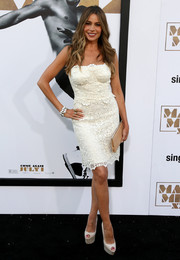 Sofia Vergara paired her dress with super-high white peep-toe pumps by Christian Louboutin.