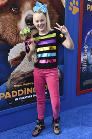 JoJo Siwa rounded out her look with a pair of beaded basketball sneakers.
