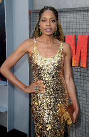 Naomie Harris paired a gold Bienen-Davis tube clutch with a sequin dress for total radiance at the premiere of 'Rampage.'