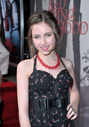 Ryan Newman paired her printed corset dress with a chunky red gemstone necklace.