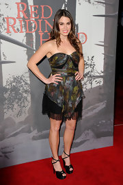 Nikki Reed accented her flirty floral premiere dress with black satin Jazziest platform sandals.