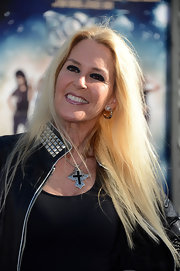Lita Ford accessorized her look with a bold silver and black cross.