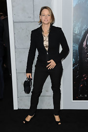 Jodie Foster kept her premiere style characteristically unfussy in a fitted black moto-style jacket and matching slacks.