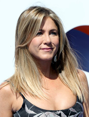 Jennifer Aniston opted for a straight center-parted hairstyle when she attended the premiere of 'Storks.'