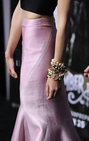 Jena Malone paired her elegant evening wear with multi-hued pearl bracelets.