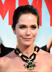 Katie Aselton complemented her strapless dress with a chunky black and gold statement necklace during the premiere of 'Tammy.'