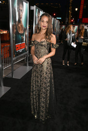 Alicia Vikander looked regal in a metallic lace off-the-shoulder gown by Louis Vuitton at the premiere of 'Tomb Raider.'