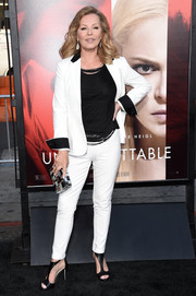 Cheryl Ladd polished off her sleek and stylish look with a patchwork box clutch.